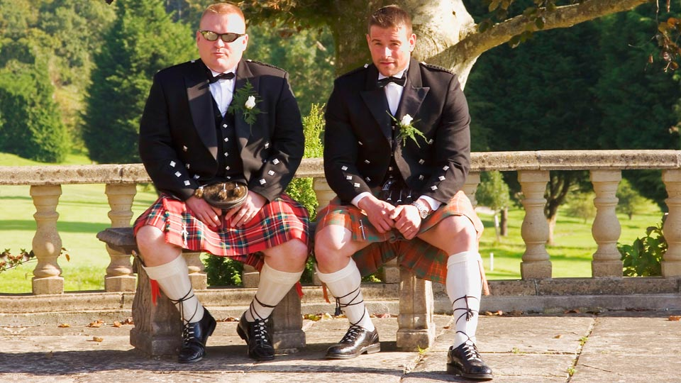 Two kilted men at a wedding