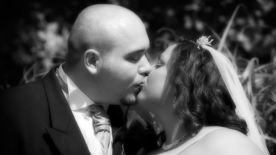 A couple kissing on their wedding day