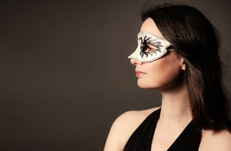 Artistic portrait of a woman in a Venetian mask.