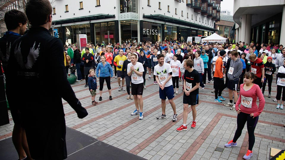 Competitors warming up for the Exeter Age UK 10K run.